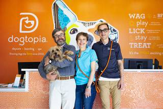 From left, owner Hiram Toro holding Milo, owner/operator Glenda Alemany-Toro and general manager Daniel Toro pose for a photo at Dogtopia, Monday, Feb. 24, 2020.