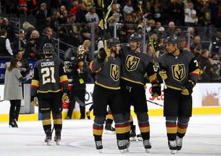 Vegas Golden Knights center William Karlsson (71), defenseman Nick Holden (22), and right wing Ryan Reaves (75) celebrate after the Golden Knights shut out the Edmonton Oilers, 3-0, at T-Mobile Arena in Las Vegas Wednesday, Feb. 26, 2020.