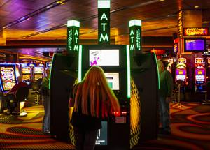 Guests use the ticket redemption kiosks at M Resorts, Thursday, Feb. 5, 2020. The kiosks at M Resort's allow players to donate loose change from winning tickets via the Everi Cares Giving Module. (Las Vegas Sun / Yasmina Chavez)