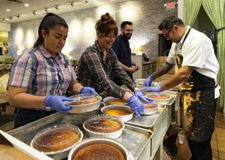 From left, server Fatima Zaldana, server Caity Many and Chef Todd Harrington put lids on to-go orders of corn bread at Honey Salt in Summerlin, Thursday, March 19, 2020. Honey Salt is continuing to provide to-go orders amid the COVID-19 quarantine period.