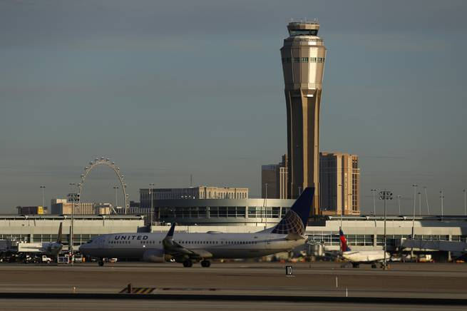 A plane takes off at McCarran International airport, Thursday, March 19, 2020, in Las Vegas.   Officials at  the airport said in a tweet that it will remain open with reduced operations after an air traffic controller tested positive late Wednesday, temporarily closing the control tower.  (AP Photo/John Locher)