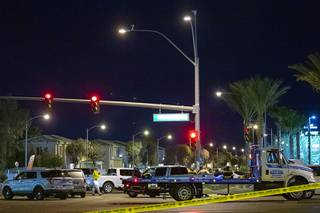 Metro Police work the scene of a fatal single-car accident on Silverado Ranch and Las Vegas boulevards Saturday, March 21, 2020. The driver, the sole occupant, died in the crash.