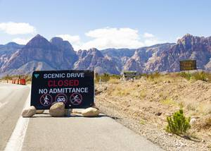 A sign indicates closure of the Red Rock Canyon scenic ...
