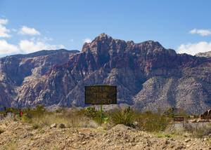 A sign indicates closure of the Red Rock Canyon scenic drive, Tuesday, March 24, 2020.