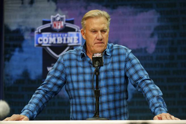 In this Feb. 25, 2020 file photo Denver Broncos general manager John Elway speaks during a news conference at the NFL football scouting combine in Indianapolis. NFL teams are having to rely more heavily on game film of college prospects as they prepare for the draft at a time when the COVID-19 pandemic has halted business as usual. On Tuesday, March 31, 2020 Elway said in a conference call,