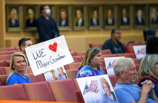 A woman holds a sign in support of Las Vegas Mayor Carolyn Goodman during a city council meeting at Las Vegas City Hall in downtown Las Vegas Wednesday, May 6, 2020.