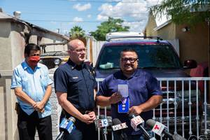 North Las Vegas Fire Chief Joseph Calhoun, along with North Las Vegas Councilman Isaac Barron, presents Jose Alvarado with a medal for his heroic actions Wed. May 20, 2020. Alvarado and another man, Vincent Torres, rescued two men from a burning house fire this past weekend.