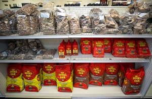 A variety of wood and charcoal is displayed at Larry's Great Western Meats, 420 S. Valley View Blvd., Thursday, May 21, 2020.
