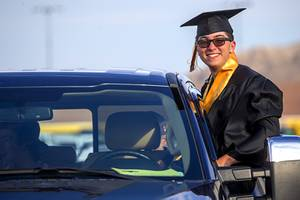 Conor Moore poses in his pickup truck as he waits for the start of the Faith Lutheran High School graduation at the Las Vegas Motor Speedway Friday, May 22, 2020. Seniors listened to speakers via a radio broadcast in their cars, then received their diplomas and took a