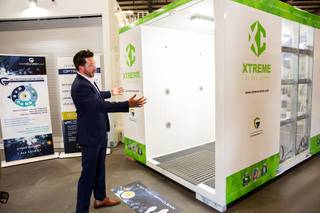 Brandon Main, CEO of Xtreme Manufacturing, speaks on the process behind their new Xtreme Opti-Clean Cube, a portable 360 degree walk-through disinfecting machine that utilizes an all-natural dry mist, Monday, June 22, 2020.