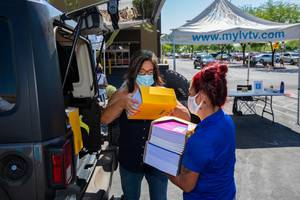 Crystal Walker, from Builder United, drops off boxes school supplies ...
