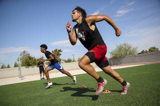 From left, Silverado High's Jaden Thrower and Vegas High's Fernando Carmona, Jr. train, Monday, Aug. 17, 2020.