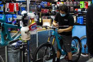 Bicycle mechanic Nico Cerna builds a Yeti brand mountain bike at Pro Cyclery, Wednesday, Aug. 19, 2020.