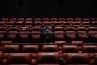 The Regal Sunset Station multiplex in Henderson reopened Thursday night after sitting empty for five months in eerie pandemic-forced exile. One of the first people to take a center seat, popcorn and orange soda in hand, was Brian Truitt, who bought tickets to ...