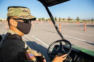 2nd Lieutenant Gideon Brillantes of the Nevada National Guard explains the procedures in place at the new COVID-19 testing centers at Sam Boyd Stadium, Monday Aug. 31, 2020.