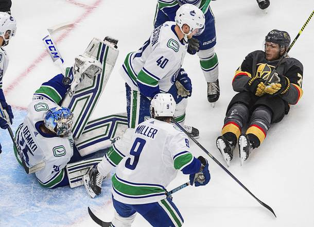 Vancouver Canucks goalie Thatcher Demko (35) makes a save as Vegas Golden Knights' William Karlsson (71), and Canucks' Elias Pettersson (40) and J.T. Miller (9) scramble in front of the net during the second period of Game 7 of an NHL hockey second-round playoff series, Friday, Sept. 4, 2020, in Edmonton, Alberta.