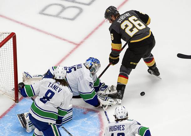 Vancouver Canucks goalie Thatcher Demko (35) makes a save against Vegas Golden Knights' Paul Stastny (26) during second-period NHL Western Conference Stanley Cup playoff hockey action in Edmonton, Alberta, Friday, Sept. 4, 2020.