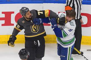 Vancouver Canucks' Jake Virtanen (18) and Vegas Golden Knights' Ryan Reaves (75) rough it up during the first period of Game 7 of an NHL hockey second-round playoff series, Friday, Sept. 4, 2020, in Edmonton, Alberta.