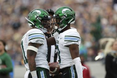 Tulane running back Amare Jones, left, congratulates wide receiver Darnell Mooney after he caught a touchdown pass against Navy during the first half of an NCAA college football game, Saturday, Oct. 26, 2019, in Annapolis.
