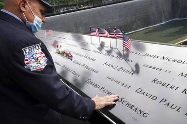 Americans commemorated 9/11 on Friday as a new national crisis — the coronavirus pandemic — reconfigured anniversary ceremonies and a presidential campaign carved a path through the observances. In New York, victims' relatives gathered ...