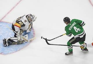 Dallas Stars' Miro Heiskanen (4) is stopped by Vegas Golden Knights goalie Robin Lehner (90) during the third period of Game 4 of the NHL hockey Western Conference final, Saturday, Sept. 12, 2020, in Edmonton, Alberta.