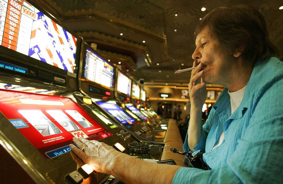 In this Dec. 28, 2005, file photo, Judy King of Daytona Beach, Fla., holds her cigarette while playing a slot machine at the MGM Grand in Las Vegas.