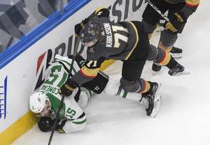 Dallas Stars' Blake Comeau (15) is checked by Vegas Golden Knights' William Karlsson (71) during third-period NHL Western Conference final playoff game action in Edmonton, Alberta, Monday, Sept. 14, 2020.