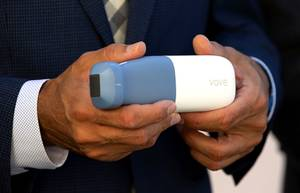 Amin Nikoozadeh, CEO of Vave Health, holds a portable ultrasound ...