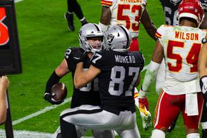 Las Vegas Raiders tight end Jason Witten (82) celebrates with Foster Moreau (87) after scoring a touchdown against the Kansas City Chiefs during the fourth quarter of their game at Allegiant Stadium Sunday, Nov. 22, 2020.