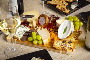A cheese board by Valley Cheese & Wine Cheesemonger Diana Brier with Brie Gres, Gouda, Adarre, Angico Brazilian Acacia Honey, Dried Cranberry, Dark Chocolate Disks, Apricots, Grapes, Macadamia Nuts, Cherries, Almonds and Crisp Bread Friday, July 17, 2020.