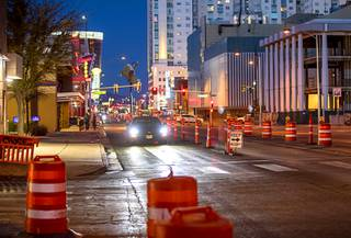 A car makes its way through construction cones southbound on Las Vegas Boulevard in downtown Las Vegas Tuesday, Dec. 22, 2020. Las Vegas Boulevard construction planning started 12 years ago and broke ground in late April. The project is expected to be complete by May of 2023.