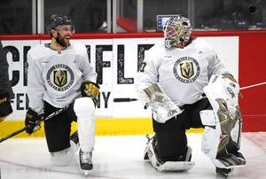 Vegas Golden Knights defenseman Alex Pietrangelo (7) talks with goaltender Robin Lehner (90) during training camp at City National Arena Wednesday, Jan. 6, 2021.