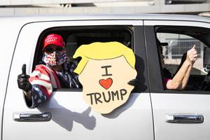 Supporters of President Donald Trump gather in front of the Lloyd D George Courthouse in downtown Las Vegas during a