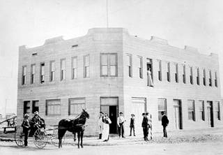 A view of Hotel Nevada after its opening in 1906 in downtown Las Vegas. Founder J.F. Miller is seated in the carriage. The Golden Gate Casino was opened in hotel in 1955. The property was renamed Golden Gate Hotel and Casino in 1974.