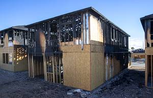 Fire damage is shown on three homes under construction at a KB Homes community near Spring Mountain Road and Durango Drive Saturday, Feb. 13, 2021. No injuries were reported in the Friday night fire.