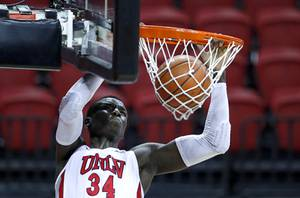 UNLV Rebels forward Cheikh Mbacke Diong (34) dunks during a game against the Fresno State Bulldogs at the Thomas & Mack Center Wednesday, Feb. 24, 2021.