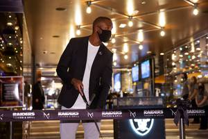 Former Raider and Pro Football Hall of Famer Charles Woodson prepares to cut the ceremonial ribbon during opening of the Raiders Tavern & Grill at the M Resort Spa & Casino, Wed. March 31, 2021.