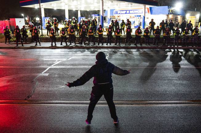 Protest after chief says officer meant to use Taser, not gun