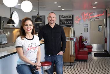 Sunshine Ray and her husband Johnny Church pose in their restaurant Johnny C's diner, 8175 Arville St.,Thursday, April 15, 2021. Church runs the diner and Ray runs Atlas Plumbing with help from her brother. Ray's father Bob Ray started the plumbing business in 1990. STEVE MARCUS