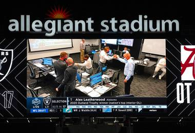 The Las Vegas Raiders Draft Room is shown on the screen at Allegiant Stadium after draft pick, Alabama tackle Alex Leatherwood, is announced Thursday, April 29, 2021.