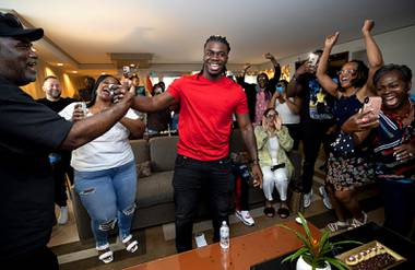 Rhamondre Stevenson, center, a Centennial High School and Las Vegas Sun player of the Year in 2015, is congratulated by family and friends in a suite at Aria, after he is drafted by the New England Patriots in the fourth round Saturday, May 1, 2021.