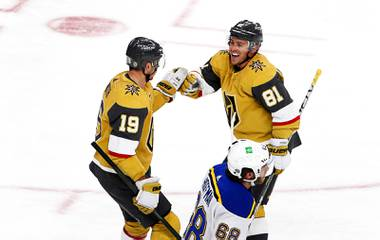 Vegas Golden Knights center Jonathan Marchessault (81) congratulates right wing Reilly Smith (19) after Smith's hat trick goal in the third period of a game against the St. Louis Blues at T-Mobile Arena Saturday, May 8, 2021. St. Louis Blues left wing Mike Hoffman (68 )is at bottom center