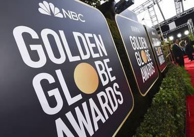 Signage promoting the 77th annual Golden Globe Awards and NBC appears in Beverly Hills, Calif. on Jan. 5, 2020. NBC said Monday that will not air the Golden Globes in 2022.