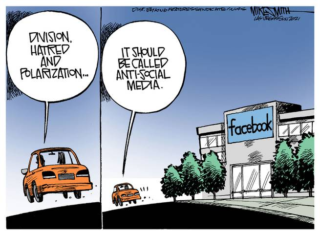 Two persons in car driving past Facebook headquarters.  One says,