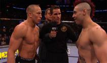 Shane Carwin nabs the interim heavyweight belt after his KO of Frank Mir in the first round, while Georges St. Pierre maintains his welterweight title.