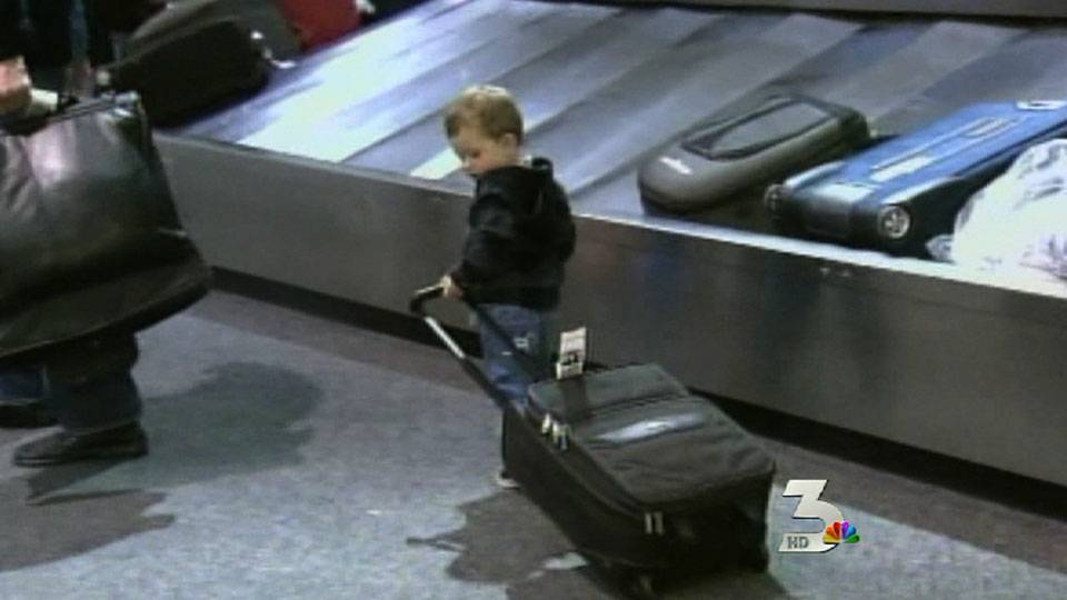 Holiday travelers pack airport