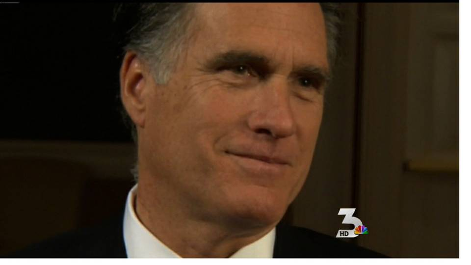 Romney leads pack into caucus