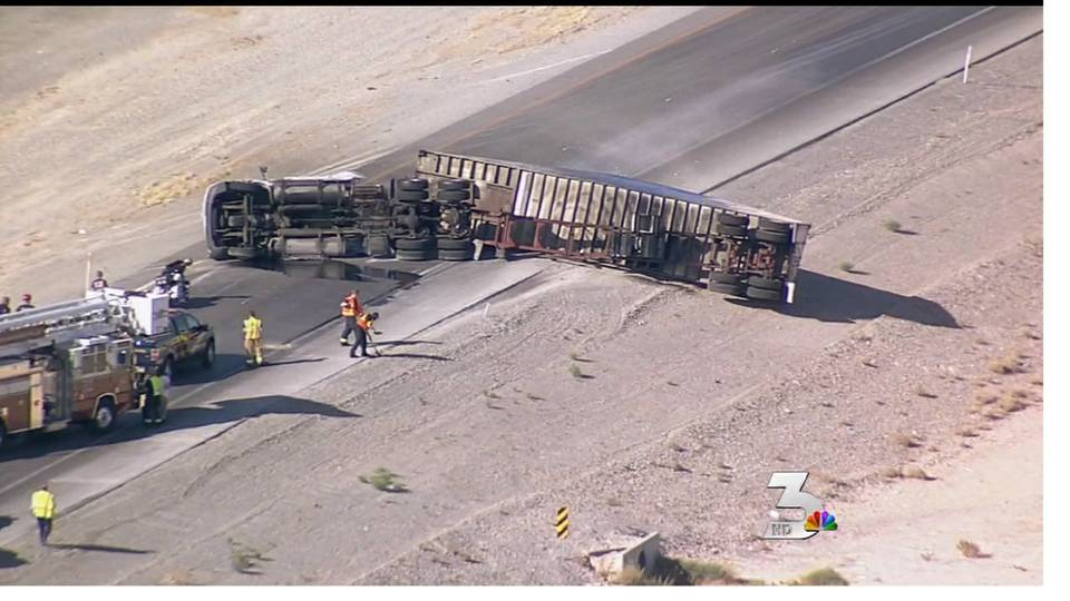 Semi-truck rolls over on I-15