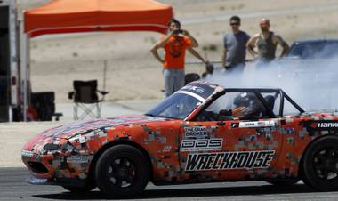 Formula Drift driver Danny George of Las Vegas takes his 1990 WreckHouse Mazda Miata around an oval at the Willow Springs International Raceway near Rosamund, Calif. Sunday, April 28, 2013. George will compete in round two of the 2013 season at Atlanta on May 10-11.